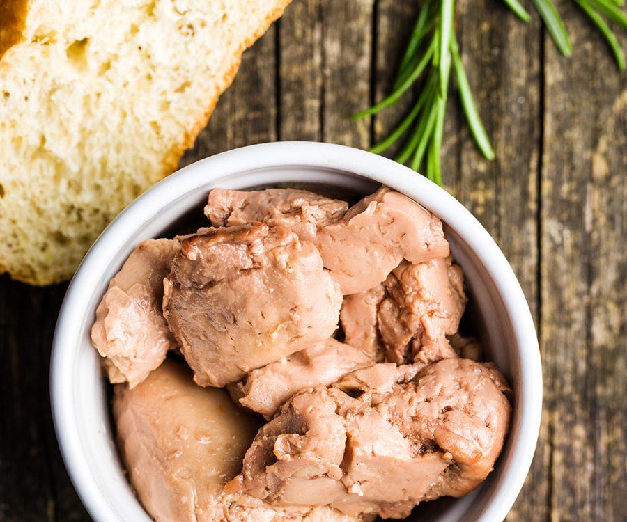 Cod liver in oil in bowl.
